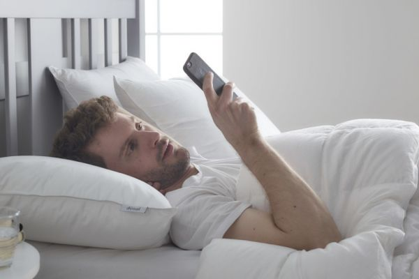 Man in bed on smart phone